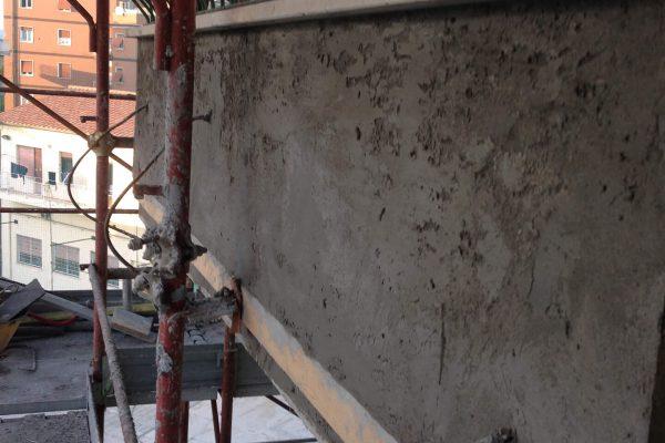 Rinzaffo con malta cementizia tirata a fratazzo